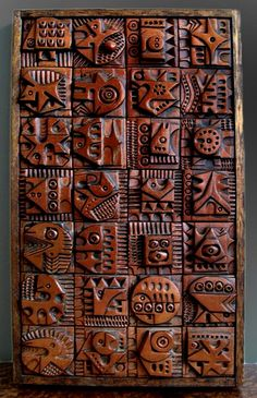 This is made by artist Evelyn Ackerman and done on wood wall panel. I really like this piece. I like the repeated square pattern where each square has carved its own figure Ceramic Wall Art, Wood Wall Art, Wood Panel Walls, Wood Paneling, Wood Sculpture, Wall Sculptures, Tiki Art, B 13, Mid Century Art