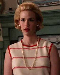"Episode 8: Betty's Red and White Knit  ""She is reprimanding Sally and I loved the strength of the red and pink very thin stripes. It's perfectly conservative and the perfect politician's wife outfit,"" said Bryant. ""Betty is always maintaining that façade of perfection."""