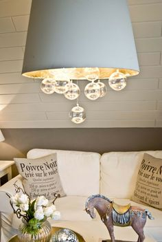 Sooo doing this! I already have my Ikea shade and light. I wonder how much gold leaf to buy... That stuff's 'spensive!