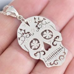 Sterling Silver Sugar Skull Pendant A hand cut beautiful piece! This Sugar Skull is made by carefully sawing and cutting the design into the