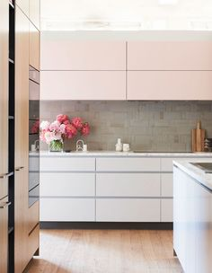blush pink kitchen cabinets at The Design Files Open house 2018  Kitchen by Cantilever with matt white cabinetry and wood veneer cupboards  handmade neutral Tiles by anchor ceramics for splash back   #blushpinkkitchen