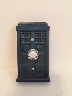 This is a really cool tardis doorbell. Made of sturdy resin and painted with a color changing paint. As you turn it or walk toward it, it will change colors from dark blue to dark green to purple. Color Changing Paint, Tardis, Color Change, Dark Blue, Nerd, Etsy Shop, Yellow, Purple, Green