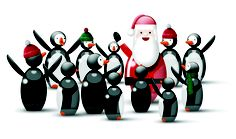 Santa with his penguins on parade for Christmas