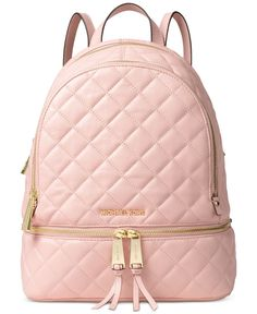 Embrace the laid-back luxury of Michael Michael Kors' quilted leather backpack, featuring a number of pockets to tote all of your stylish essentials. | Leather; lining: polyester | Medium sized bag; 1