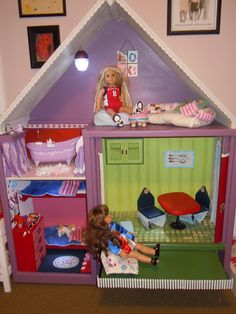 Dollhouse made out of an old entertainment center.