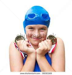 Cute adolescent girl in cobalt blue swimwear smiles proudly and holds two swimming medals close to her face. Square format, isolated on white background, copy space. - stock photo