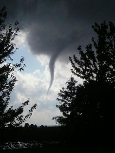 A friend shared this picture of a funnel cloud forming today about 10 miles south of us in Champaign-Urbana, Illinois