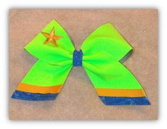 Learn how to make easy cheer bows that are vibrant and bold!  Your whole cheer team will be able to make these girls hair accessories!  Get your first lesson on how to make cheer bows for free!