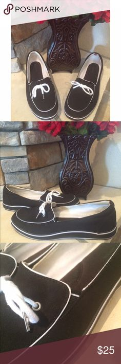 Grasshopper Boat Shoes In new condition. Only worn once!! Small stain on inside of shoe (refer to pic) def. can't see when wearing! Nice cushioned insole. Black and white canvas. Fit true to size. Grasshoppers Shoes Flats & Loafers