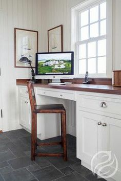 """Small spaces & homes would welcome this inset desk! If you're looking to be creative with space, this Greenfield Cabinetry example is perfect. Build a """"knee wall"""" & run drawers and a countertop between the wall and knee wall and you have a suddenly have a space to pay bills, drop mail, answer correspondence or hang out on Pinterest! #GreenfieldCabinetry #CustomCabinetry #Desk #Trend #Cabinets #Image"""