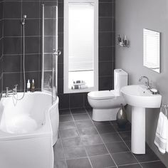 shower over bath - curved end to make shower more spacious. Note also the slate tiles