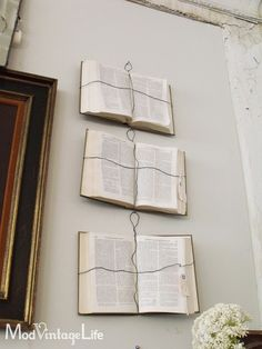 "From ""Mod Vintage Life"" in ""Antique Shopping"" -- ""I thought this was an interesting idea to hang old books on the wall with wire. I'll be filing this idea away."""