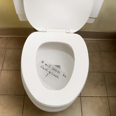 On a few squares of toilet paper, write a goofy gag line with permanent marker, then float the paper in the toilet for the next visitor to find.  Tip: For a longer floating time, allow the paper's edges to touch the sides of the bowl.