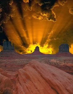 Desert Sky ~ light burst behind that rock formation, it's almost spooky it is so dramatic. Can't imagine seeing this.