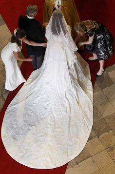 Kate, having her dress adjusted