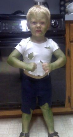 Cheap Incredible hulk costume! Old baby onesie cut up, dark blue sweat pants cut up, and food coloring mixed with hand lotion to make his skin  (: