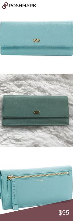 """✨NWT✨COLE HAAN Slim Leather Flap Wallet 💳 ✨NWT✨COLE HAAN Slim Leather Flap Wallet 💳. Color: Aqua Haze. Condition: NWT, No Visible Flaws❣️Foldover flap with snap closure - Exterior features 1 zip pocket - Interior features currency pockets and 16 card slots - Approx. 7.75"""" L x 3.375"""" H x 1"""" D COLE HAAN Bags Wallets"""