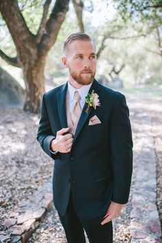 """Groom is wearing the """"Parker"""" Tuxedo from the Ike Behar Evening line.  This luxurious Tuxedo is a high end wool, slim fit, two button Tuxedo with a notch lapel.  His Tuxedo is accessorized with a champagne pocket square, Windsor tie and matching cummerbund.  Photos by Mr. & Mrs. Wedding Duo.  Venue is Milagro Farm Vineyards and Winery.  Tuxedo from A Better Deal Tuxedo, 369 Bird Rock Ave, La Jolla, CA 92037.  www.abetterdeal.com"""