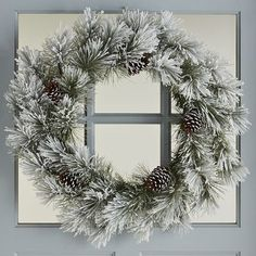 Up the outdoor charm inside your home with our handcrafted wreath. Frosted white faux pine and natural pinecones inspire a woodland wonderland, whether anchoring your holiday centerpiece or hung over the mantel. It's exactly what you've been pining for.