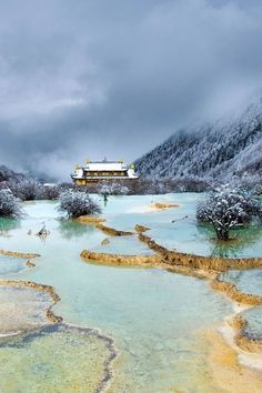 Huanglong, China - This part of China is known for the multi-colored pools of The Huanglonggu - Yellow Dragon Valley