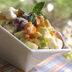 "Zesty Apple Salad Allrecipes.com    This is a perfectly healthy modification of my favorite childhood salad. The lemon low fat yogurt worked GREAT as a substitute for whipped cream. We substituted almonds for walnuts as my picky Philly Hubby ""HATES"" walnuts. It got an official Philly LIKES it! Another keeper for my healthy recipes! (also cut down the marshmellows by half if you are diabetic)"