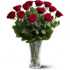 For classic romance, a dozen red roses is always the perfect choice.One dozen long-stemmed red roses in a clear glass vase.