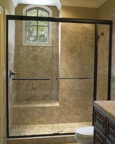 shower doors glass frameless sliding frameless shower door in a oil rub bronze finish - Kohler Shower Doors