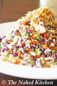 raw rainbow salad: radish, carrot, cauliflower, broccoli, purple cabbage and red onion
