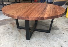 Recycled Tasmanian oak round coffee table with black metal legs
