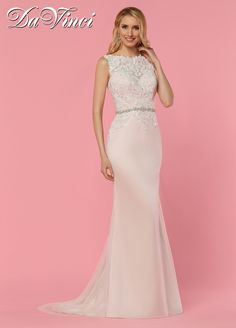 DaVinci Bridal Style # 50441 Classic bateau neckline covered in lace accented with a beaded trim. Soft tulle throughout this fit and flare gown with lace covered illusion back, and sweep train.