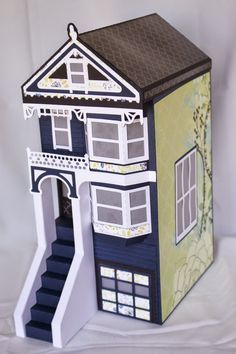 How pretty is this one made by Cynde! The deep blue really has a striking contrast with the white trim and then the yellow on the side is exactly what it needs to bring it all together! This awesome Victorian House is from the PARKSIDE ROW SVG KIT! Fabulous, Cynde!