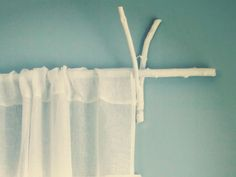10 Ahhh-mazingly Simple Decorating Ideas ::Use branches and twigs to create a curtain rod and brackets.
