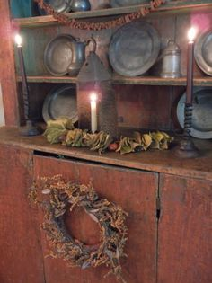 This would be so beautiful refinished. Early New England Autumn.aged cupboard with pewter dishes & candlelight. Primitive Country Homes, Primitive Fall, Primitive Antiques, Primitive Christmas, Primitive Decor, Country Cupboard, Primitive Bedroom, Prim Decor, Country Decor