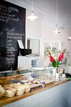 Bully's Bakery in Berlin Neukölln.  Awesome Flammkuchen, i.e. thin pizza-like pastry with ingredients of your choice, try the one with goat cheese and eggplant. Super place for your breakfast, coffee or both while staying in Neukölln. (wifi pw: flatwhite)
