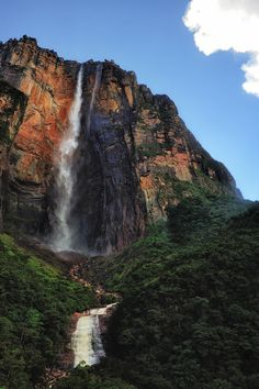 Angel Falls, the world's highest uninterrupted waterfall, with a height of 979 m ft) and a plunge of 807 m ft). The waterfall drops over the edge of the Auyantepui mountain in the Canaima National Park in Venezuela, South America Angel Falls Venezuela, World Geography, Thinking Day, Beautiful Waterfalls, Insta Photo, Virtual Tour, Natural Wonders, World Heritage Sites, South America