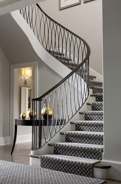Stunning white stairway with c. Stunning white stairway with carpet runner, iron railing, wood flooring Staircase Remodel, Staircase Railings, Curved Staircase, Stairways, Banisters, Staircase Ideas, Spiral Staircases, Wrought Iron Stair Railing, Stair Railing Design