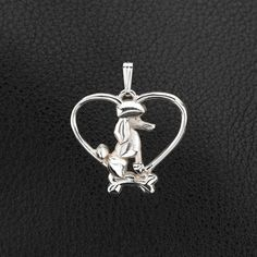 Sterling Silver Standard Poodle Pendant with Chain.  Cast from a wax carving and hand finished