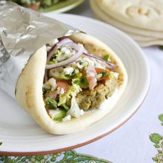 Pita Wrap! Falafel 1 16oz can chickpeas, drained and rinsed 2 Tbsp. fresh parsley ½ yellow onion, chopped 4 garlic cloves, minced 1 Tbsp. ground cumin 1 Tsp. ground coriander 2 Tbsp. cooked bulgar wheat 2 Tbsp. whole wheat flour  Lemon Tahini sauce ¼ cup tahini juice from two lemons ½ Tsp. paprika 1 garlic clove, minced  Wrap 4 pitas 1 tomato, diced ½ red onion, finely sliced ½ cucumber, halved and sliced 1 cup green leaf or romaine lettuce, shredded ¼ cup tzatziki (optional) ½ cup feta chee...
