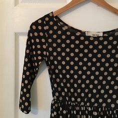 Super Cute Polka Dot Dress Love, love, love this super cute black and beige polka dot dress. Super comfy and fun to wear. Excellent, like new condition. 3/4 length arms, gathered at the waist, awesome flow to the skirt! Sans Souci Dresses Mini