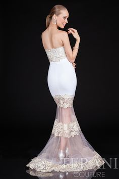 Fitted+mermaid+prom+gown+with+sweetheart+neckline+and+sheer,+flared+skirt.+This+prom+dress+is+finished+with+delicate+lace+and+floral+applique+embellishments