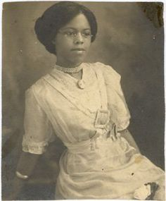 According to her great-granddaughter, this is Clara Belle Williams, the first black graduate of New Mexico State University. Many or her professors would not allow inside the class room, she had to take notes from the hallway; she was also not allowed to walk with her class to get her diploma. She became a great teacher, of black students by day, and by night she taught their parents (former slaves) home economics. she lived past 100. [20th century photos of women, on VintageBlackFolk]