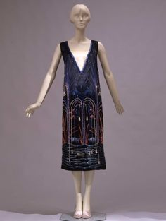 * Short sleeveless dress in black silk satin and embroidered with glass straws in different colours. The embroideries resembles plants falling into the water, looking like fireworks; Sartoria Ventura, Rome (?), 1925 ca.