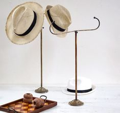Early-1900s antique brass double-ended hat stand #hats #millinery #antiques #shopdisplay #visualmerchandising #vintagedecor #fashion