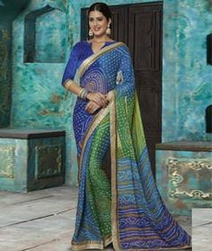 Buy Blue Chiffon Printed Saree With Blouse 72346 with blouse online at lowest price from vast collection of sarees at Indianclothstore.com.