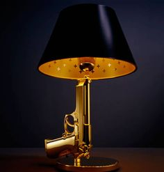 The bedside Gun Table Beretta bedside lamp by Philippe Starck for Flos lamp is a very funky that reminds the blaxploitation's movie amtosphere. The lamp is available in 18k gold-plated aluminum or in Chromed. - http://www.rgrips.com/en/article/87-browning-22-semiauto