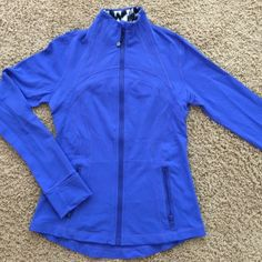 Lululemon jacket - electric blue. Like new Awesome blue lululemon forme zip up. Great material like new lululemon athletica Tops Sweatshirts & Hoodies