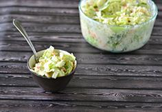 Bobby Flay's Creamy Coleslaw made with cabbage, carrot, onions, and a well seasoned and creamy slaw dressing.