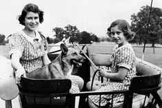 Mirror-Jan 1941: Princess Elizabeth and Princess Margaret in the garden of their wartime country residence (Windsor) where they are staying.  Photo-PA