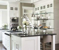 Contemporary Island Style Taupe kitchen, white cabinets, Linda McDougald Design/ Postcard From Paris, Charleston