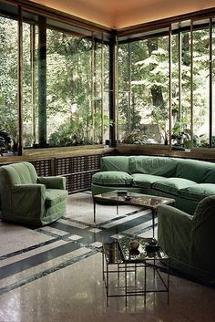.I love the shades of green, both inside and outside. I love the huge windows. I love the simple lines.